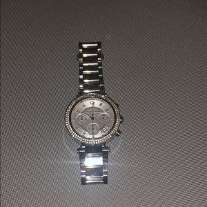 Sliver diamond rimmed Michael Kors women watch
